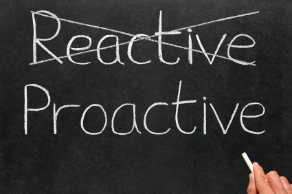 Blackboard with 'Reactive' crossed out and 'Proactive' written underneath